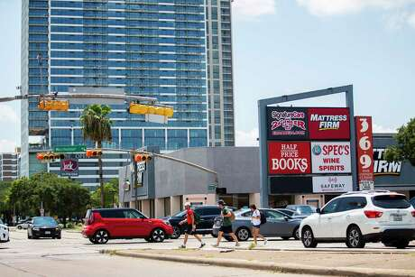 Two of the Montrose neighborhood's newer residential towers rise up just south of the property on the southwest corner of Montrose Boulevard and Westheimer Road that includes a Mattress Firm and a Half Price Books that was recently purchased by residential towers rise up just south of the Skanksa USA , Wednesday, Aug. 5, 2020, in Houston. The company paid $27 million and says it will build a retail and residential project on the site.