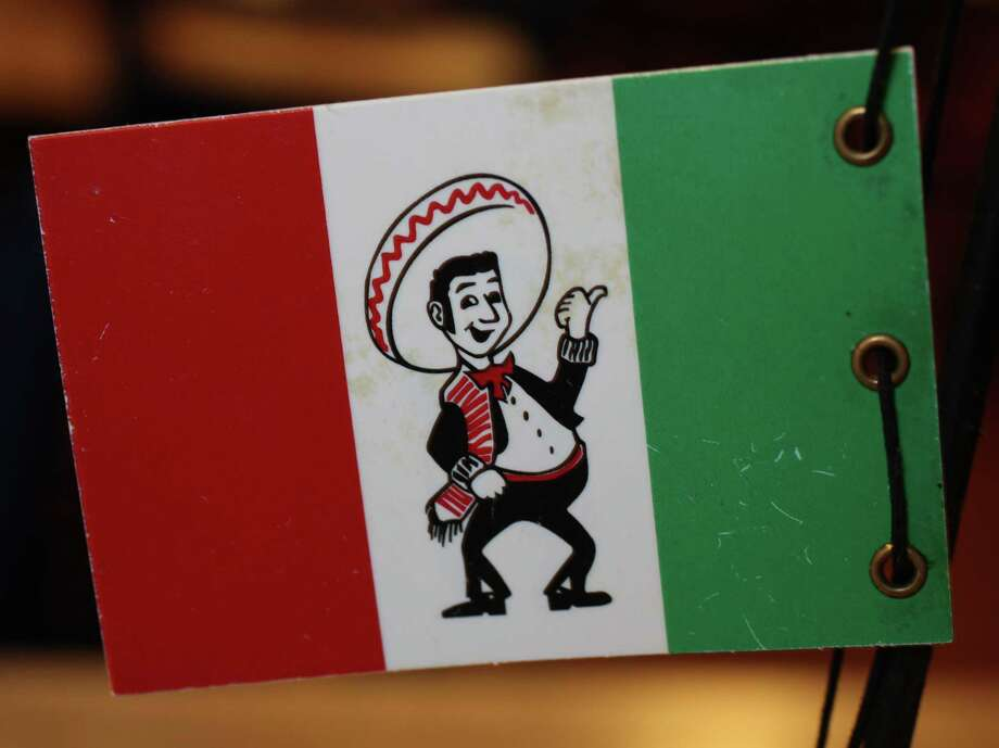 You know you get hungry for sopapillas when you see that Pancho's flag. Photo: JUANITO M GARZA, San Antonio Express-News / San Antonio Express-News