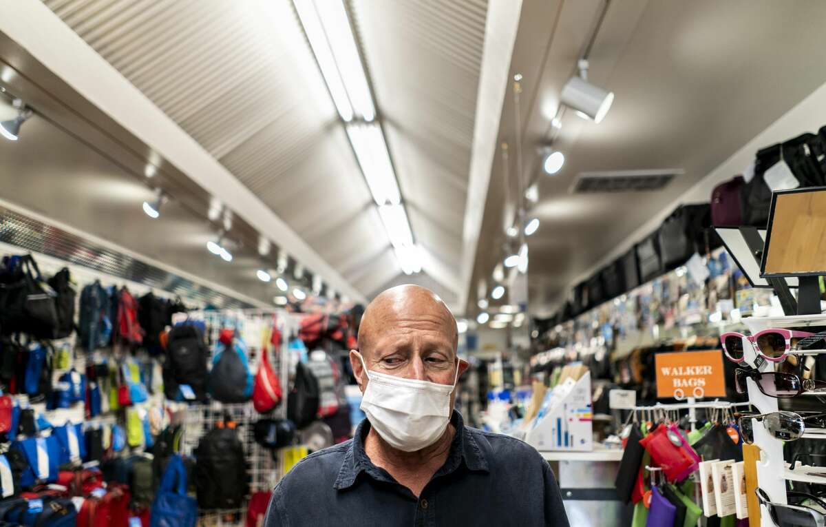 With all the social travel and health protocols followed, Bernie Schwartz, owner of California Luggage, opened up like many other businesses in downtown Santa Rosa, while California implemented Phase 3 of the economic opening plan of the state during the coronavirus pandemic in Santa Rosa, California on Friday, June 12, 2020.