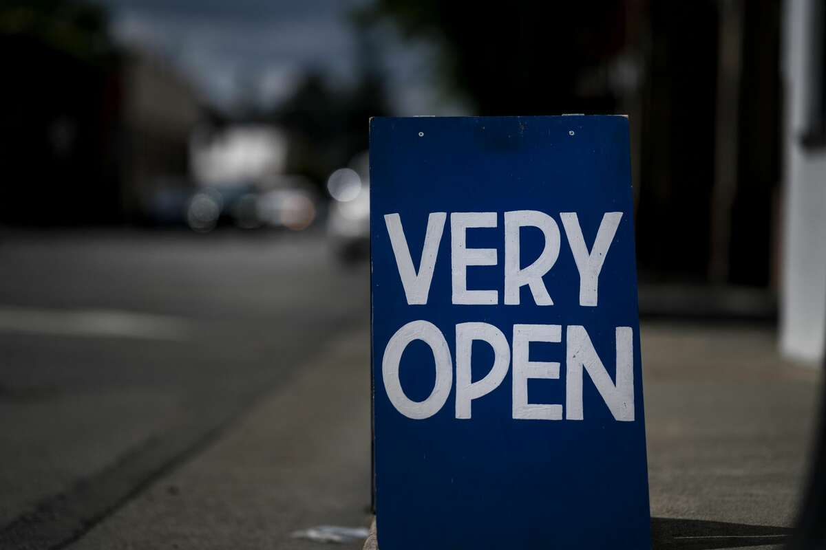 Signs of re opening businesses can be seen along Davis Street in downtown Santa Rosa, as California implements Phase 3 its state-wide economy opening plan during the coronavirus pandemic in Santa Rosa, California on Friday June 12, 2020.