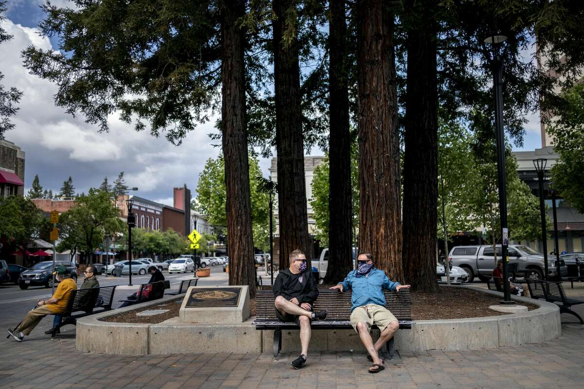 As night approaches, people gather in a quiet Old Courthouse Square in downtown Santa Rosa, while California implements Phase 3 of the state's economic opening plan during the coronavirus in Santa Rosa, California on Friday 12th. , 2020.