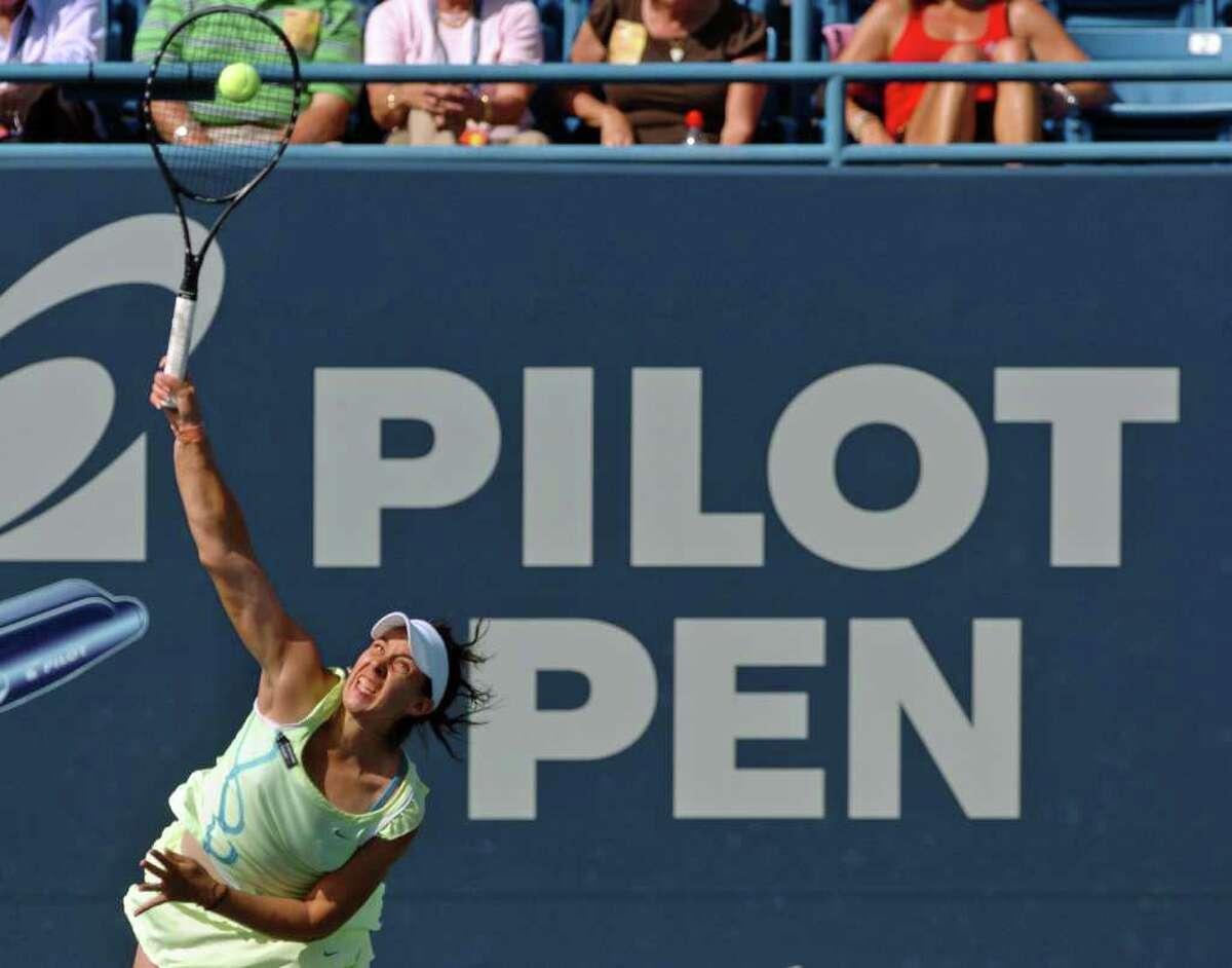 Marion Bartoli serves the ball to her opponent Elena Dementieva at the Pilot Pen tennis tournament in New Haven, Conn. on Thursday August 26, 2010. Dementieva beat Bartoli 6-3, 3-6, 6-2.