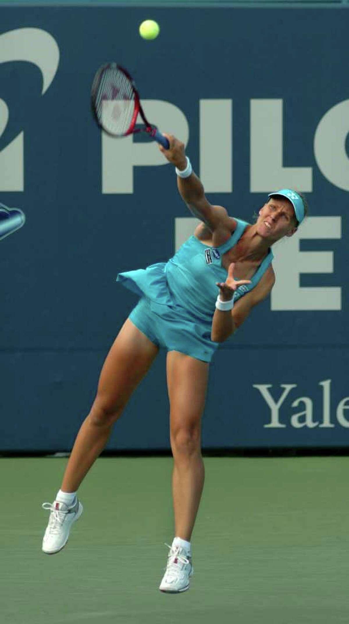 Elena Dementieva serves the ball to her opponent Marion Bartoli at the Pilot Pen tennis tournament in New Haven, Conn. on Thursday August 26, 2010. Dementieva beat Bartoli 6-3, 3-6, 6-2.