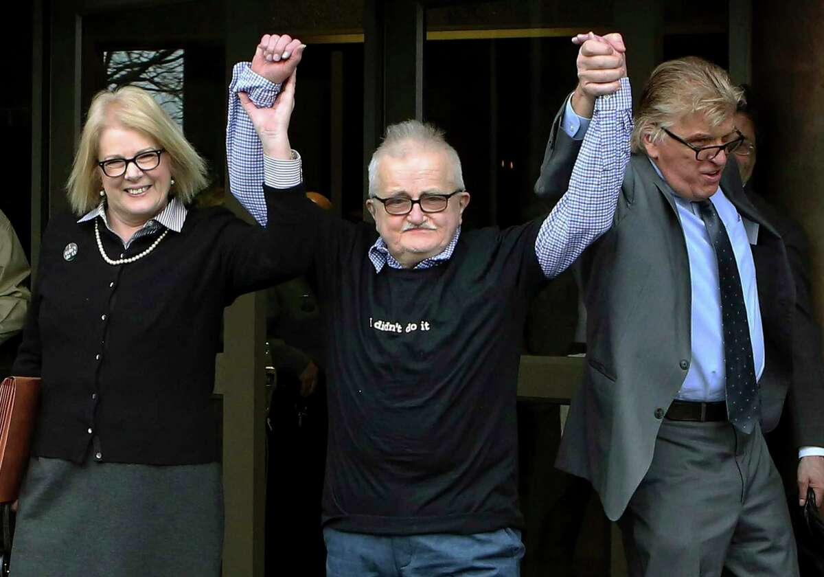 In this 2015 file photo, Richard Lapointe, center, raises his arms with Kate Germond, left, and Paul Casteleiro, both of Centurion Ministries, after he was granted bail and released at the Connecticut Supreme Court in Hartford.
