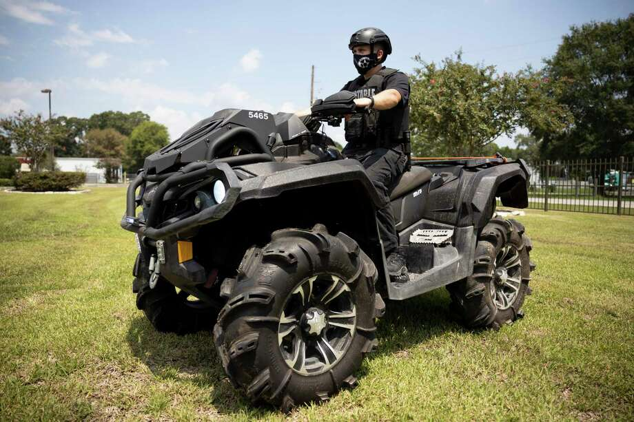 A deputy with the the Montgomery County Precinct 4 Constable's Office poses for a portrait in an all-terrain vehicle in New Caney, August 8, 2020. Photo: Gustavo Huerta, Houston Chronicle / Staff Photographer / Houston Chronicle © 2020