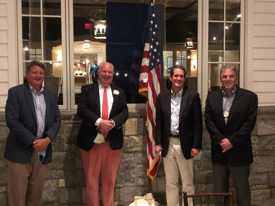 Congressman Jim Himes spoke at the New Canaan Exchange Club meeting Wednesday, Aug. 5. Himes and Exchange Club members discussed current events affecting the community. Pictured from right to left are George Bennington, president; James Ohara, speaker chair; Congressman Jim Himes and Richard Carratu, membership chair. (Masks were taken off for the photo). Photo: Contributed Photo