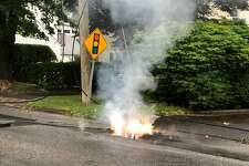 Wires down and burning on West Avenue in Darien Friday morning.