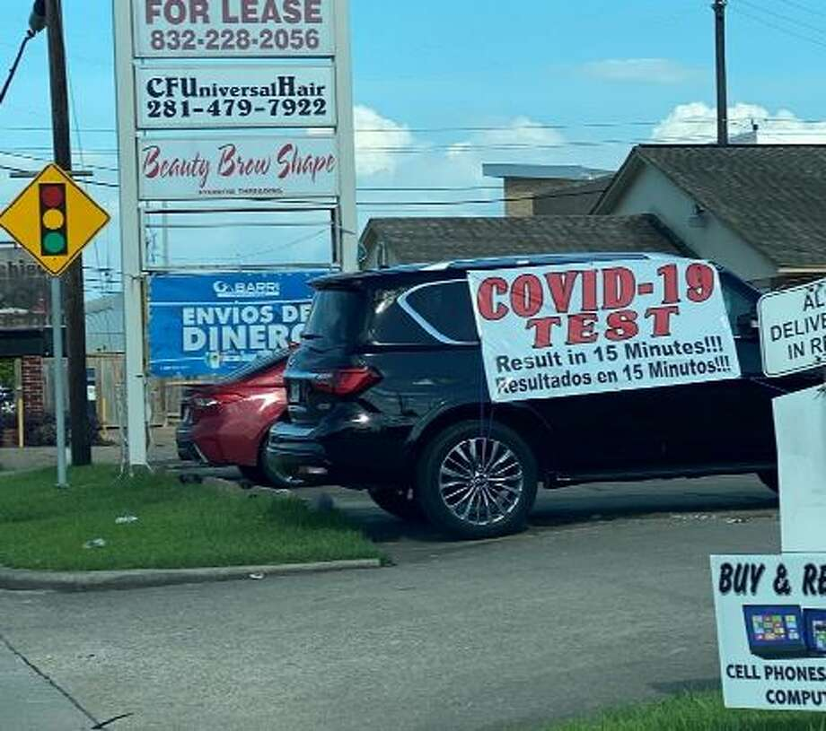 "A large sign strewn across a black Infiniti SUV that read ""COVID-19 TEST RESULTS IN 15 MINUTES!"" has drawn large crowds to the clinic for the last several weeks, per the lawsuit. Photo: Texas Attorney General Ken Paxton"