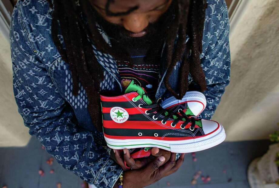 Tremaine Emory with the sneakers he designed, inspired by the Pan-African flag. He says the sneaker, a collaboration with Converse, will drop in October and that marketing for the shoe will encourage voting in the November election. Photo: Jason Armond, MBR / TNS / Los Angeles Times
