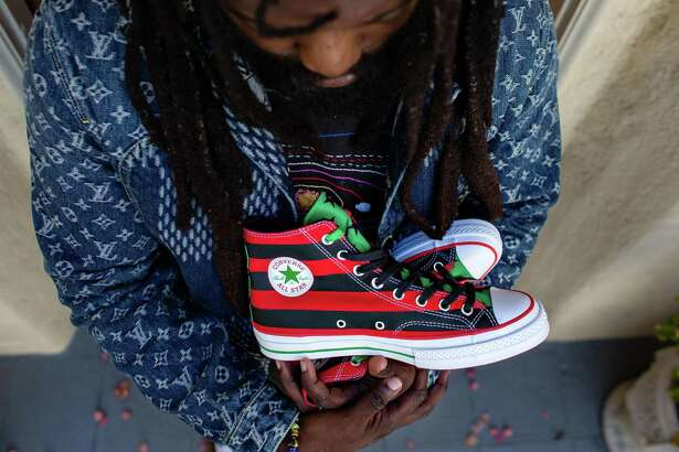 Tremaine Emory with the sneakers he designed, inspired by the Pan-African flag. He says the sneaker, a collaboration with Converse, will drop in October and that marketing for the shoe will encourage voting in the November election.