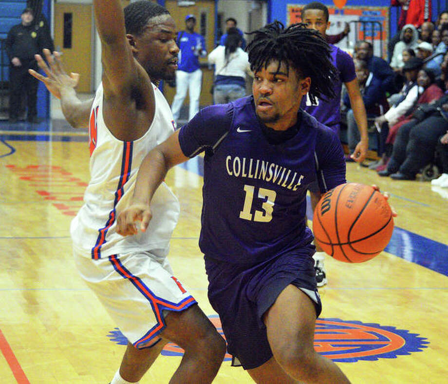 Collinsville's Ray'Sean Taylor (13) drives on a Flyers defender during a game last season in East St. Louis. Taylor, a Class 4A all-stater for the Kahoks and a heralded freshman recruit for SIUE, has suffered a torn ACL. Photo: Hearst Illinois File Photo