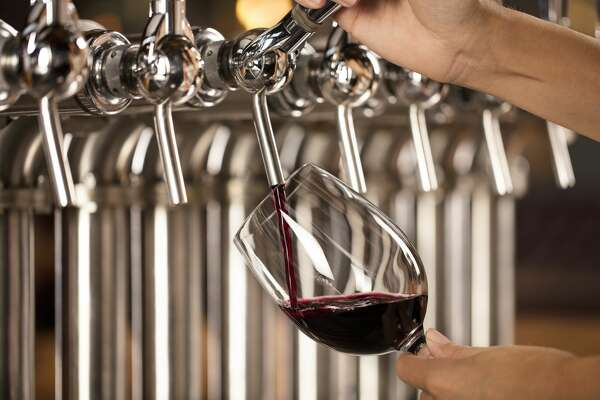 Wine being poured from a keg tap