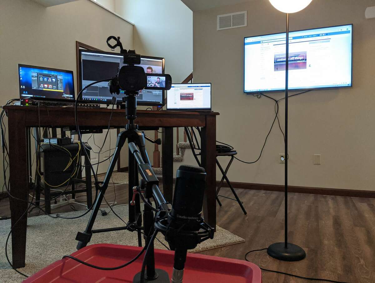 """The """"home studio"""" for Mike Whitaker, lead pastor of The Connection Faith Community, is his living room, where he broadcasts worship services on Facebook Live and smaller meetings on Zoom."""