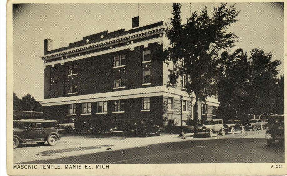 A view of the Masonic Temple looking southeast circa early 1930s. The Kroger Grocery store, today's Manistee News Advocate, would later be constructed on the corner of Water and Maple street. (Manistee County Historical Museum photo)