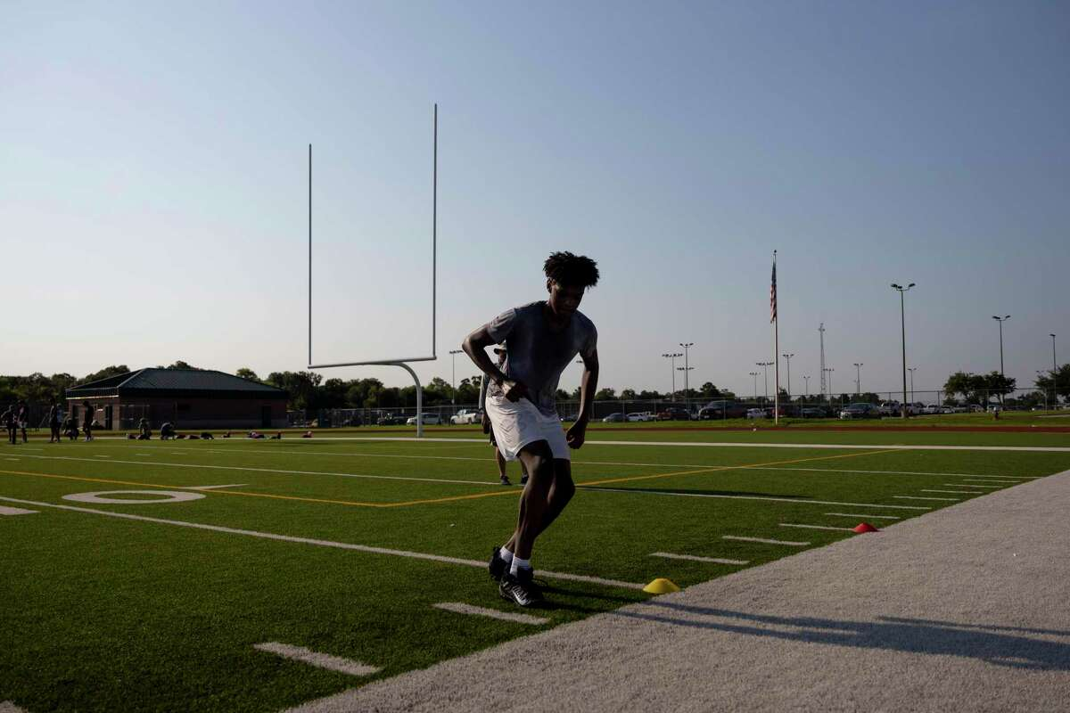 Jahiem O'hara, goes through an agility drill at Cypress Woods High School, Wednesday, August 5, 2020. They team has adopted some social distancing practices during training.