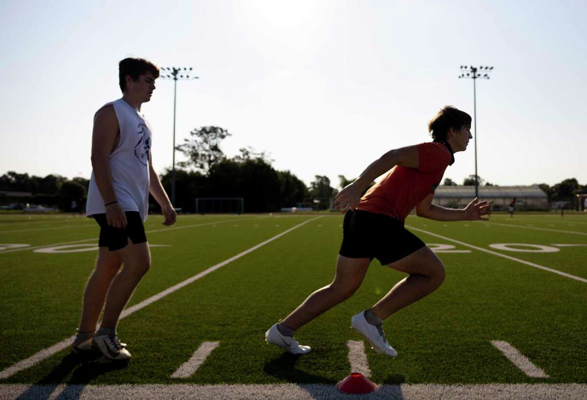 Cypress Woods High School football players go through agility drills at Cypress Woods High School, Wednesday, August 5, 2020. They team has adopted some social distancing practices during training.