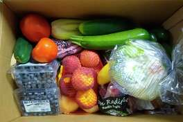 The senior center food bank takes place on the third Friday of the month from 9-11 a.m. The next food bank will be on Aug. 21. Seniors received a box of fresh produce during the produce food bank on Friday. (Courtesy photo)