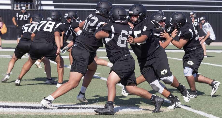 Big Spring football players run drills 8/07/2020 during practice. Tim Fischer/Reporter-Telegram Photo: Tim Fischer/Midland Reporter-Telegram