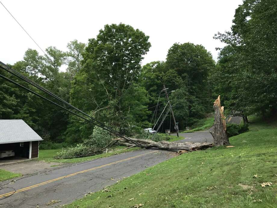 After tropical storm Isaias , a large tree and fallen wires are blocking Westwood Drive near Lindencrest Drive in Danbury on Thursday, Aug. 6, 2020. Photo: Julia Perkins / Hearst Connecticut Media / The News-Times
