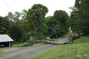 After tropical storm Isaias , a large tree and fallen wires are blocking Westwood Drive near Lindencrest Drive in Danbury on Thursday, Aug. 6, 2020.