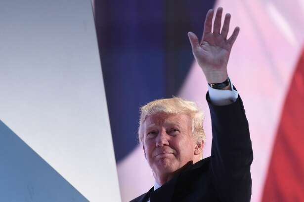 TOPSHOT - Republican Presidential candidate Donald Trump waves as he leaves the stage during the Republican National Convention at the Quicken Loans Arena in Cleveland, Ohio on July 20, 2016. The cost of the convention for the Republican Party will run some $64 million. The number of visitors expected in Cleveland is 50,000, including 15,000 journalists and 2,472 delegates (there are also 2,302 alternate delegates.) / AFP PHOTO / Robyn BECKROBYN BECK/AFP/Getty Images
