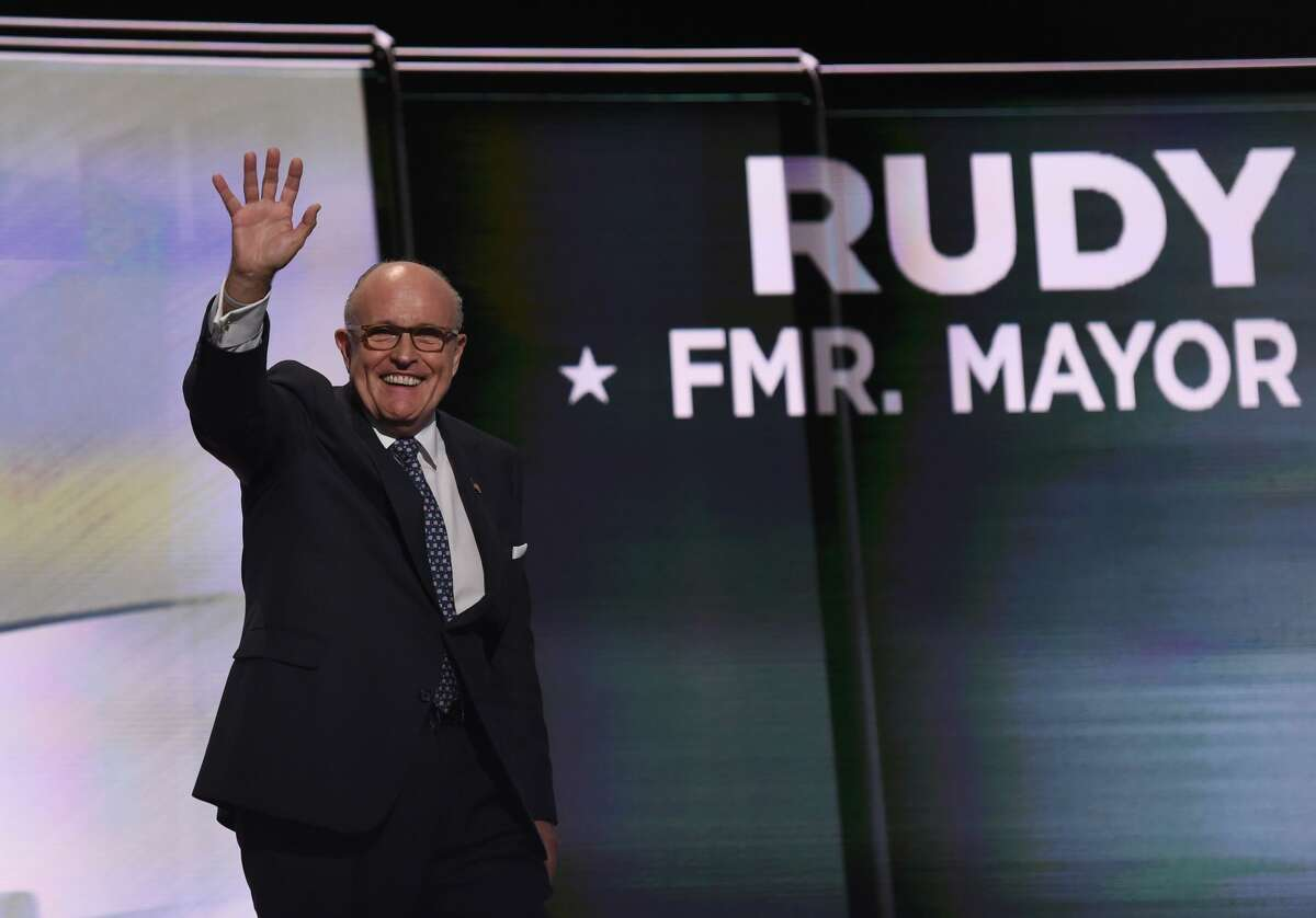 (FILES) In this file photo taken on July 18, 2016 Former New York City Mayor Rudy Giuliani waves on the first day of the Republican National Convention at the Quicken Loans Arena in Cleveland, Ohio. / AFP PHOTO / TIMOTHY A. CLARYTIMOTHY A. CLARY/AFP/Getty Images