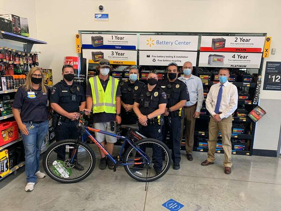 A Cibolo man was gifted a new bicycle by the Cibolo Police Department after his was stolen outside a local Walmart. Photo: Cibolo Police Department