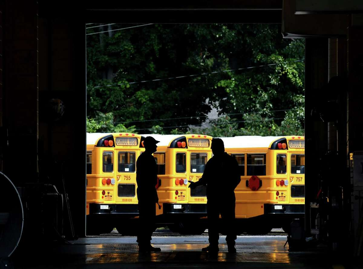 School buses at the Shenendehowa Central School District bus garage a prepared for the new school year on Friday, Aug. 7, 2020, in Clifton Park, N.Y. Gov. Andrew Cuomo said that schools can open this fall. (Will Waldron/Times Union)