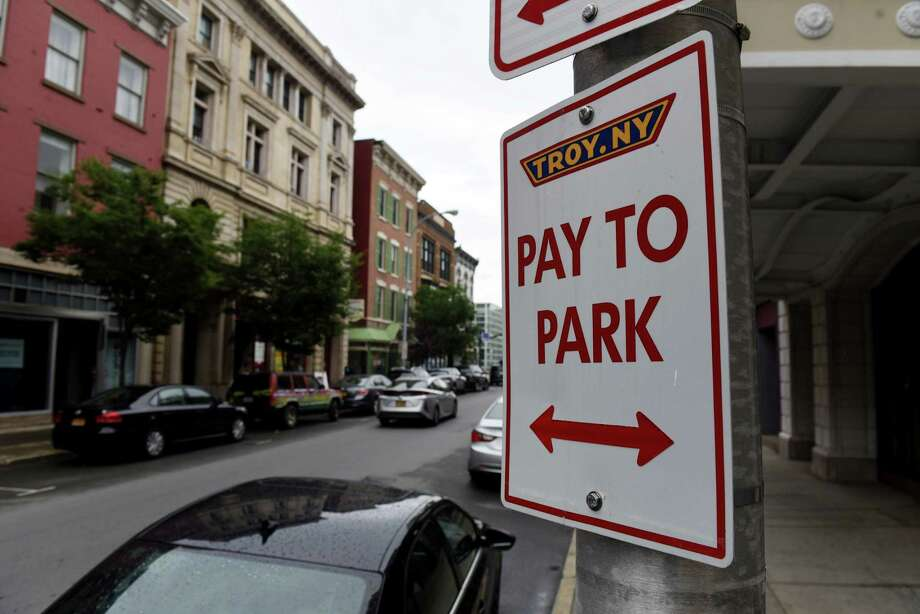 Pay to park signs are seen on Fourth Street on Friday, Aug. 7, 2020, in Troy, N.Y. Troy is adopting a parking app that may eventually turn into a regional app with Albany and Schenectady. (Will Waldron/Times Union) Photo: Will Waldron, Albany Times Union / 20049740A