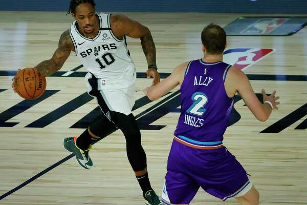 LAKE BUENA VISTA, FLORIDA - AUGUST 07: DeMar DeRozan #10 of the San Antonio Spurs looks to pass as Joe Ingles #2 of the Utah Jazz defends during the second quarter at HP Field House at ESPN Wide World Of Sports Complex on August 07, 2020 in Lake Buena Vista, Florida. NOTE TO USER: User expressly acknowledges and agrees that, by downloading and or using this photograph, User is consenting to the terms and conditions of the Getty Images License Agreement. (Photo by Kevin C. Cox/Getty Images)