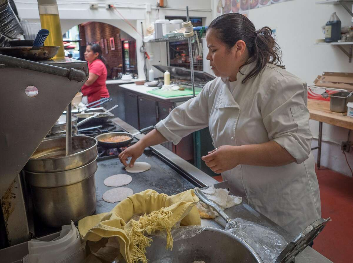 Chef/Owner Dilsa Lugo makes tortillas at Los Cilantros in Berkeley, Calif. is seen on Wednesday, July 30th, 2014.