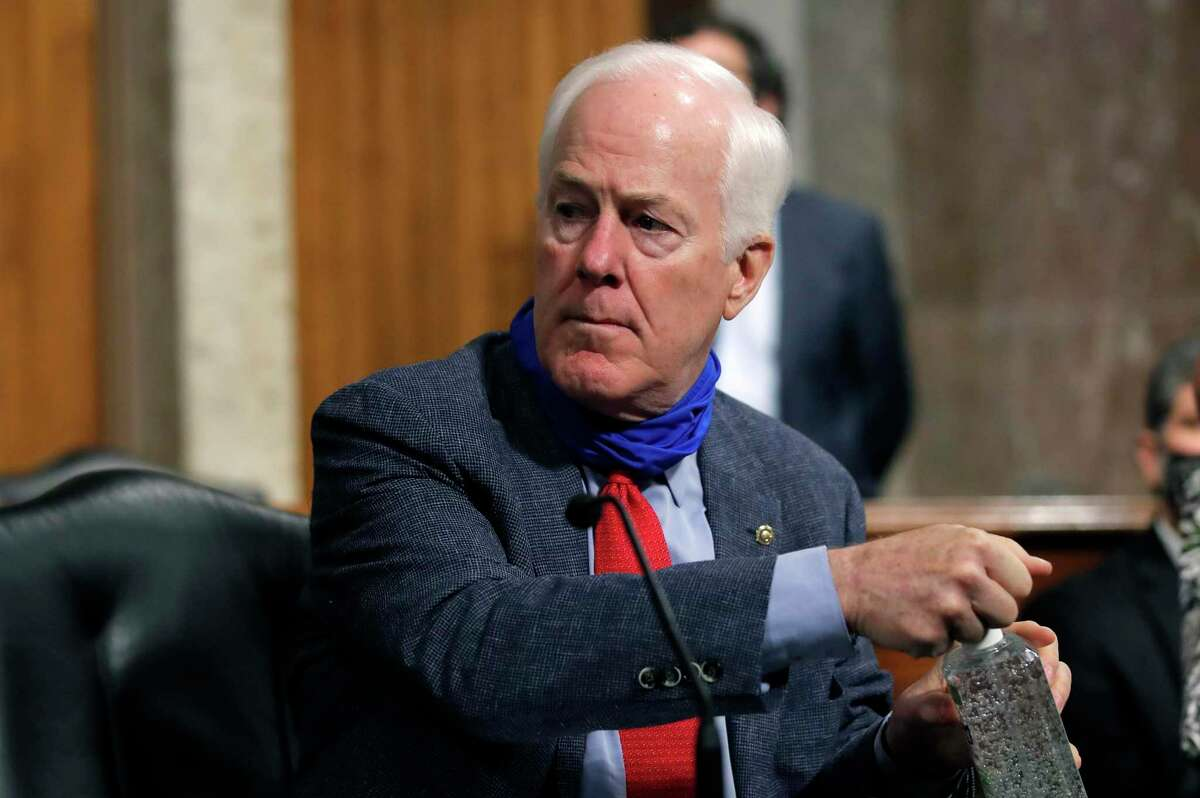 WASHINGTON, DC - JUNE 11: Sen. John Cornyn, R-Texas, uses hand sanitizer before a Senate Judiciary Committee business meeting on Capitol Hill on June 11, 2020 in Washington, DC. Senate committee gathered to vote on authorizing 35 subpoenas into the origins of the FBIs Russia investigation, dubbed Crossfire Hurricane. (Photo by Carolyn Kaster-Pool/Getty Images)