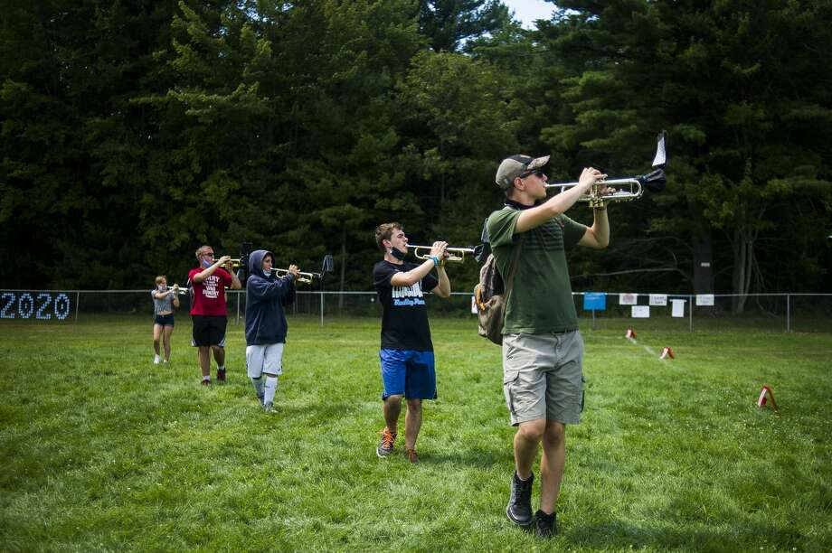 Mark Tippin, right, plays his instrument with fellow band members as the Meridian Early College High School marching band rehearses Friday, Aug. 7, 2020 at the school. (Katy Kildee/kkildee@mdn.net) Photo: (Katy Kildee/kkildee@mdn.net)