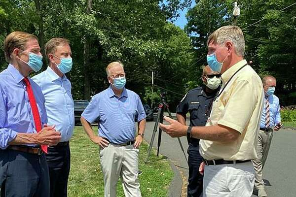 U.S. Sen. Richard Blumenthal, left, Gov. Ned Lamont and Mayor Mark Boughton hear from T.J. Wiedl, Danbury's emergency management director, during Lamont's tour of storm damage in Danbury on Aug. 8, 2020.