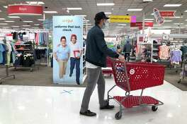 COLMA, CALIFORNIA - AUGUST 03: An advertisement for back-to-school uniforms is displayed at a Target store on August 03, 2020 in Colma, California. In the midst of the ongoing coronavirus pandemic, back-to-school shopping has mostly moved to online sales, with purchases shifting from clothing to laptop computers and home schooling supplies. (Photo by Justin Sullivan/Getty Images)