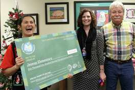 The Pasadena ISD Education Foundation is striving to keep donations coming during the pandemic for projects such as this $1,172 minigrant check for bilingual learning software that it awarded Jessup Elementary School teacher Maria Lucord in 2017.