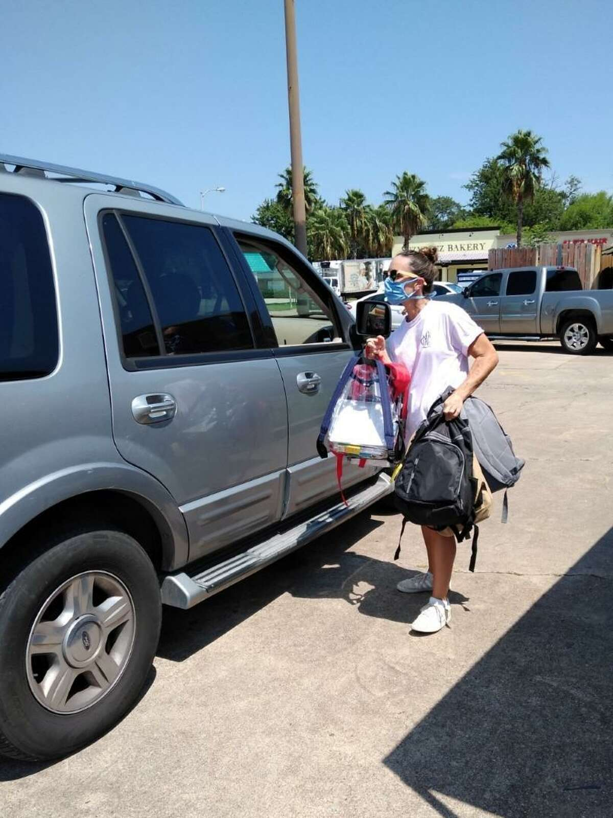 Cypress Assistance Ministries began distributing backpacks and school supplies on Monday, Aug. 3. In order to maintain social distancing and keep everyone safe they are using a drive-thru method where visitors show ID and proof of school registration for their children.