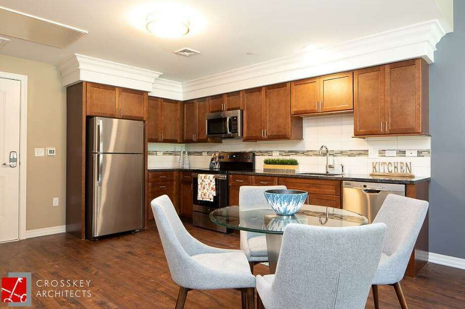 A kitchen in an apartment in the newly constructed The Royle at Darien. Photo: Josh Schaperow / Connecticut Post