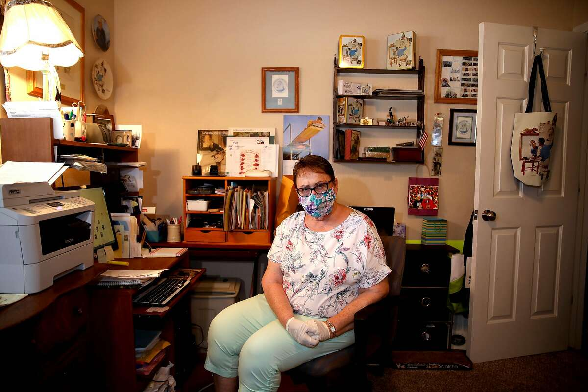 Donna Larsen poses for a portrait in her home work office on Tuesday, August 4, 2020, in Redding, Calif. Larsen's son Keith Doolin is a 47-year-old death row inmate at San Quentin State Prison. Larsen works on Keith's case every day and has 76 boxes of post-conviction evidence.