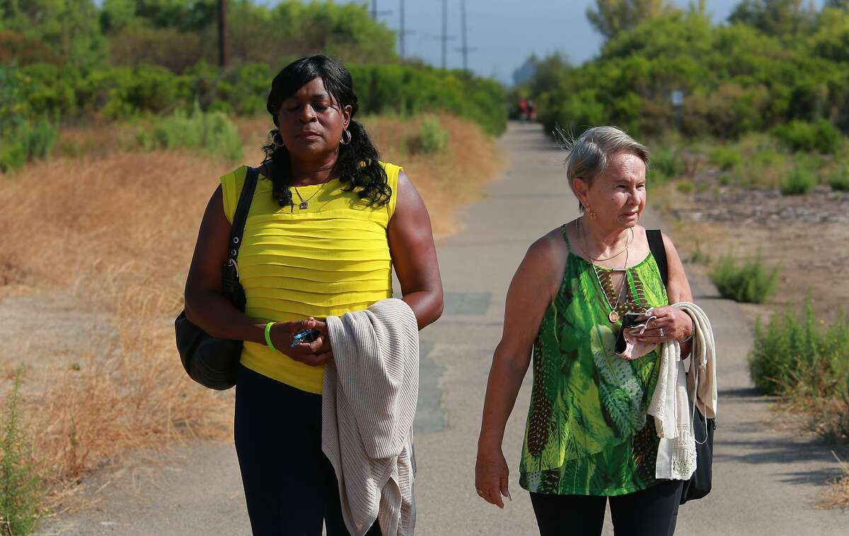 On Tuesday, July 30, 2020 in San Diego, California, USA, Milena Phillips, mother of Jonathan Sellers, left, has an emotional moment as she and Maria Keever, mother of Charlie Keever, returned to the bayside bike path in San Diego near the southern end of San Diego Bay where their sons were kidnapped and murdered in 1993. The site was heavily overgrown, and a landmark bridge had disappeared but the women had no trouble identifying the exact spot where their sons� bodies were discovered. The killer was on death row at San Quentin until he recently died from complications of the coronavirus.