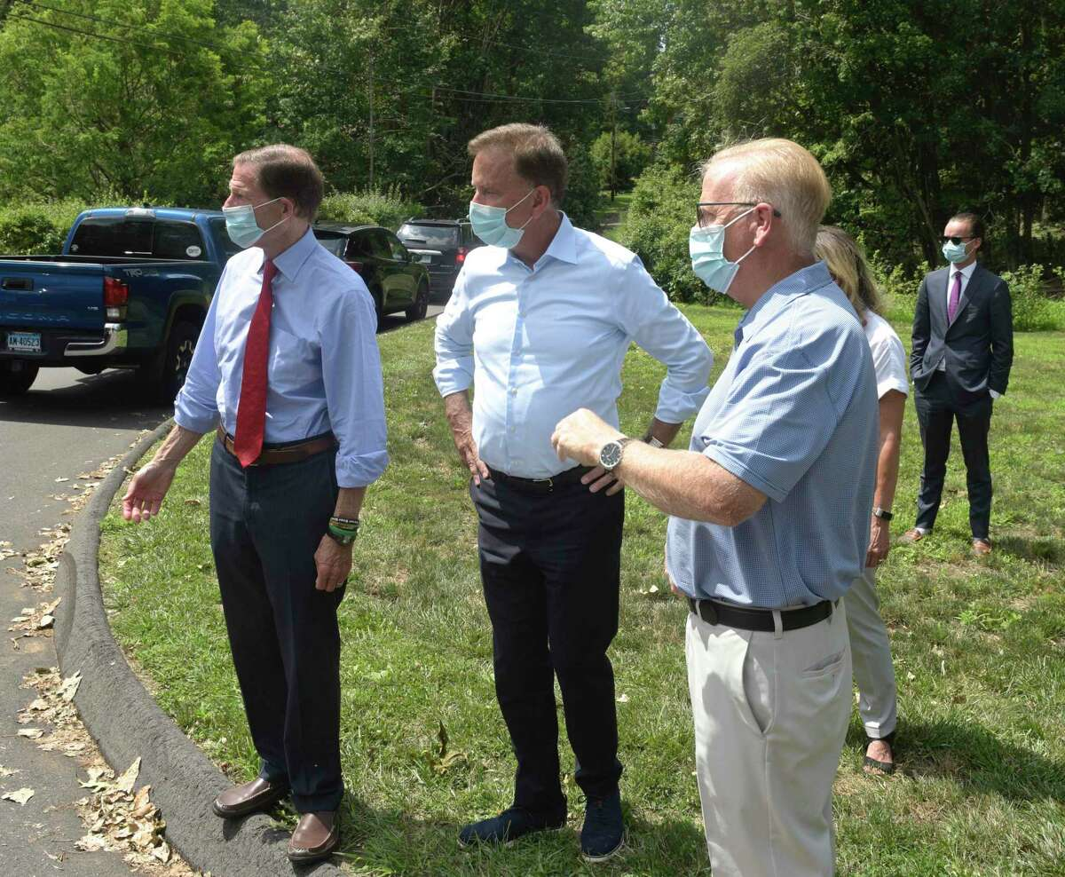U.S. Senator Richard Blumenthal, left, Governor Ned Lamont and Mayor Mark Boughton, right, viewed the damage after the tropical storm hit Connecticut in August.