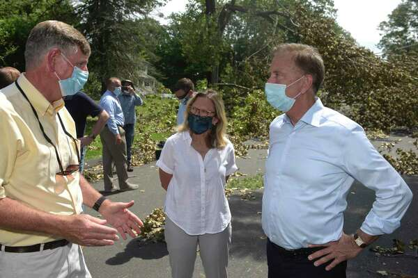 Governor Ned Lamont, right, State Senator Julie Kushner, and TJ Wiedl, director of Emergency Management City of Danbury, view damage from Tuesday's tropical storm Isaias. Judith Drive ,Friday, August 7, 2020, in Danbury, Conn.