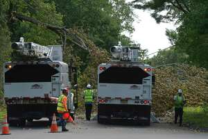 A crew shows up to remove a fallen tree from Tuesday's tropical storm Isaias. Judith Drive Friday, August 7, 2020, in Danbury, Conn.