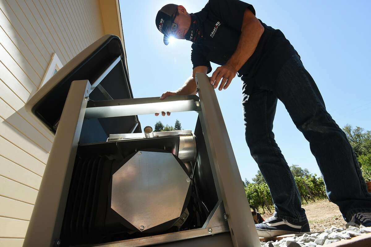 Richard Kirby of Firebrand Safety Systems Inc., inspecting a recently installed 20 kilowatt generator at a home in the Hidden Hills neighborhood of Santa Rosa, Calif., on August 6, 2020.
