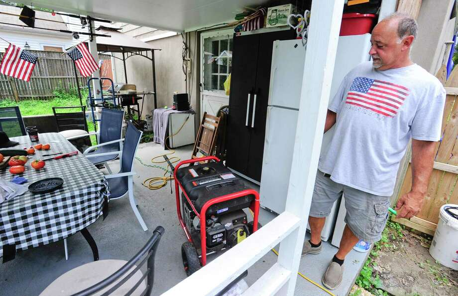 Gary Pellini of Stamford checks his generator on August 7, 2020 in Stamford, Connecticut. Pellini lost power at his home on Frisbie Street during the overnight, as crews in the area work to restore and repair downed utility lines brought down by fallen trees in the wake of Tropical Storm Isaias in his Glenbrook neighborhood. Photo: Matthew Brown / Hearst Connecticut Media / Stamford Advocate