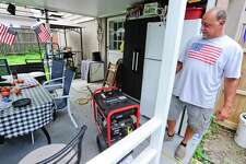 Gary Pellini of Stamford checks his generator on August 7, 2020 in Stamford, Connecticut. Pellini lost power at his home on Frisbie Street during the overnight, as crews in the area work to restore and repair downed utility lines brought down by fallen trees in the wake of Tropical Storm Isaias in his Glenbrook neighborhood.