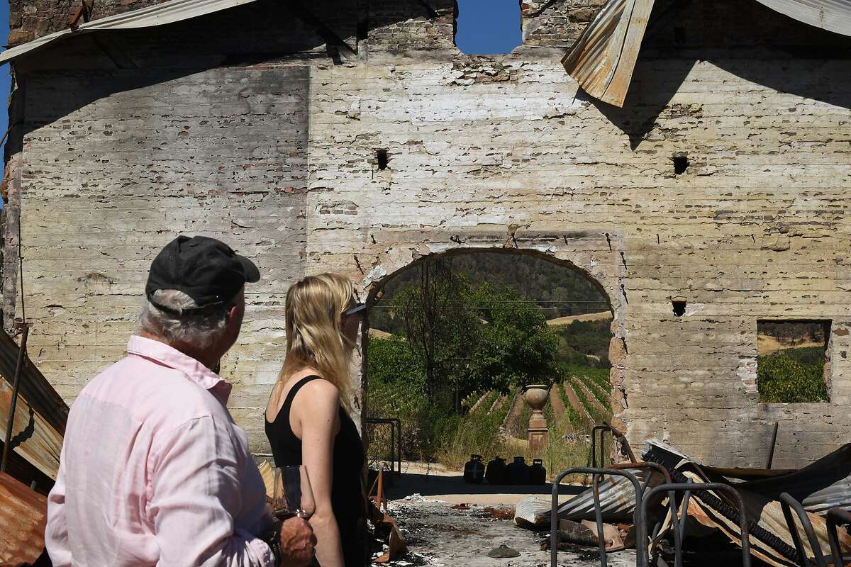 Soda Rock Winery owner Ken Wilson, left, with his daughter Victoria Wilson, 32, looking over the remains of his winery which was destroyed during the 2019 Kincade Fire in Healdsburg, Calif., on August 6, 2020.