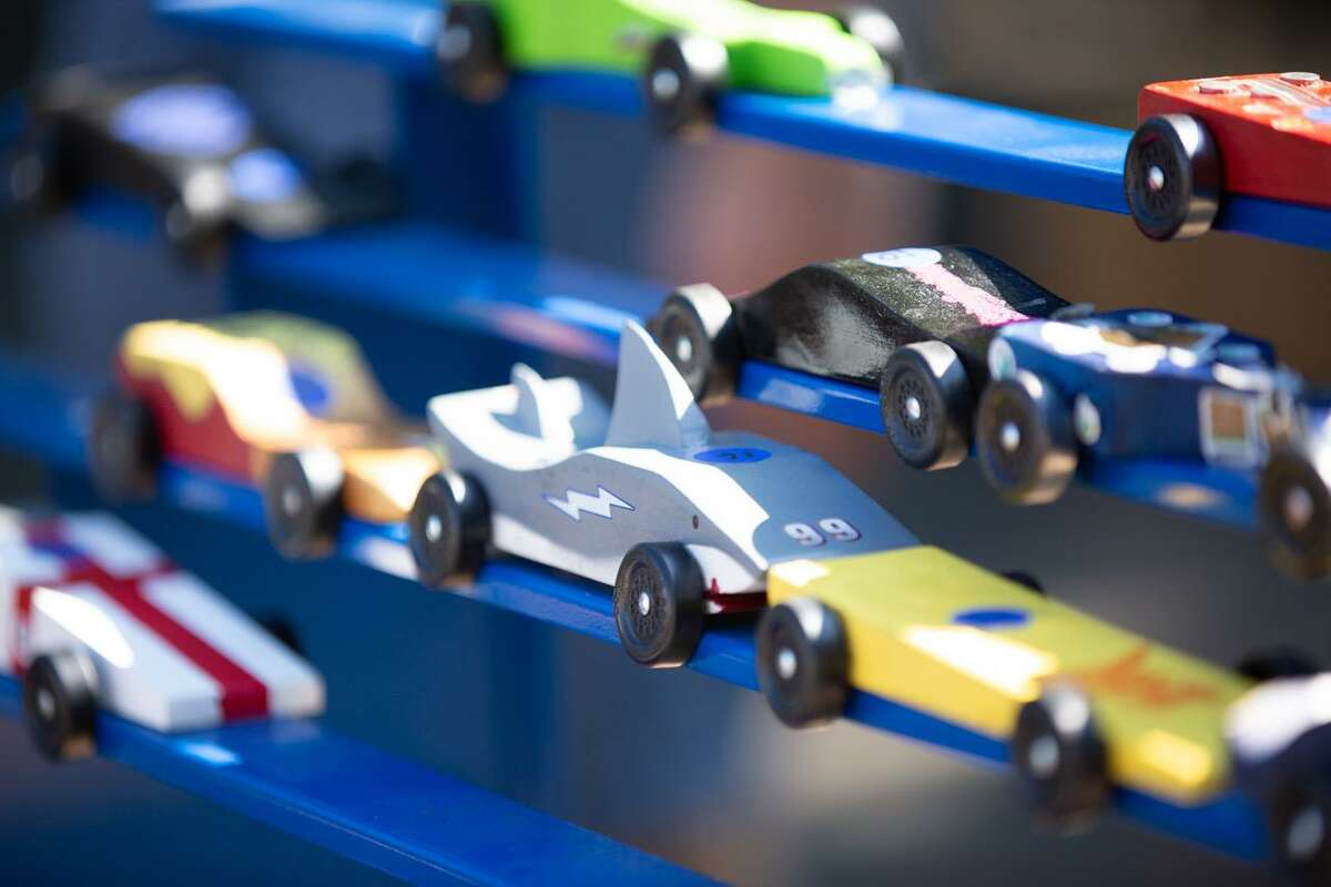 Some of the Pinewood Derby cars designed and created by the Cub Scouts.