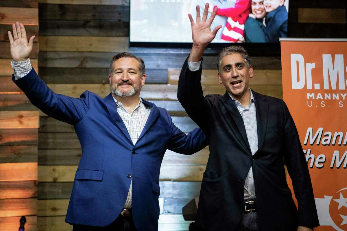 Sen. Ted Cruz, R-Texas, left, and Republican U.S. Senate candidate Dr. Manny Sethi, right, wave after speaking during a town hall meeting at Music City Baptist Church in Mt. Juliet, Tenn., Friday, July 24, 2020. (Andrew Nelles/The Tennessean via AP)
