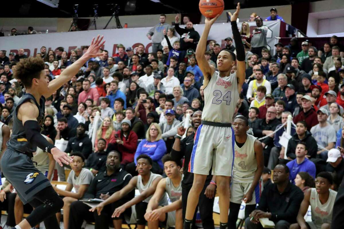 DeMatha's Jordan Hawkins #24 takes a jumper against Rancho Christian during a high school basketball game at the Hoophall Classic, Monday, January 20, 2020, in Springfield, MA. (AP Photo/Gregory Payan)